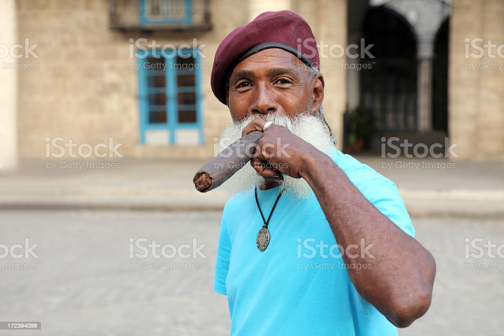 Cuban man smoking big cigar royalty-free stock photo