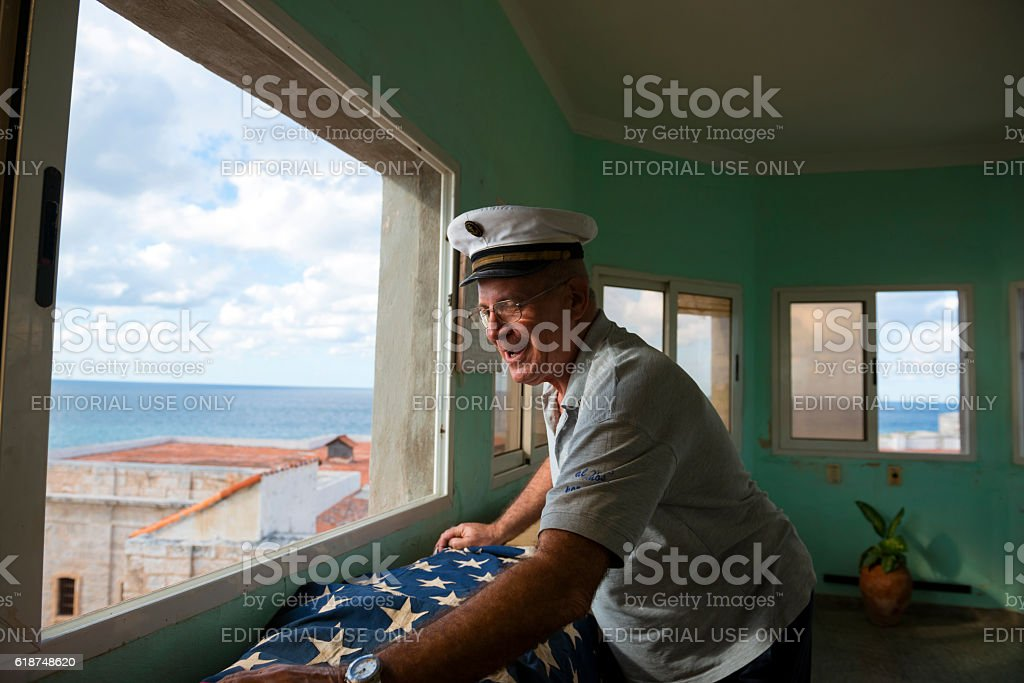 Cuban man with American flag in Havana stock photo