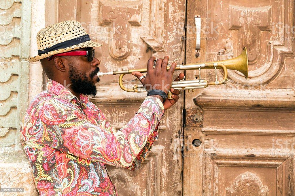 Cuban musician playing trumpet in Havana stock photo