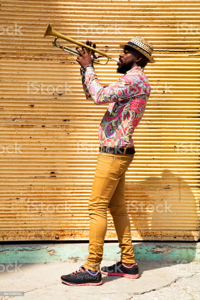 Cuban musician playing trumpet in Havana stock photo