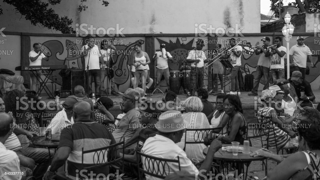 Cuban people watching a salsa band live, Trinidad stock photo