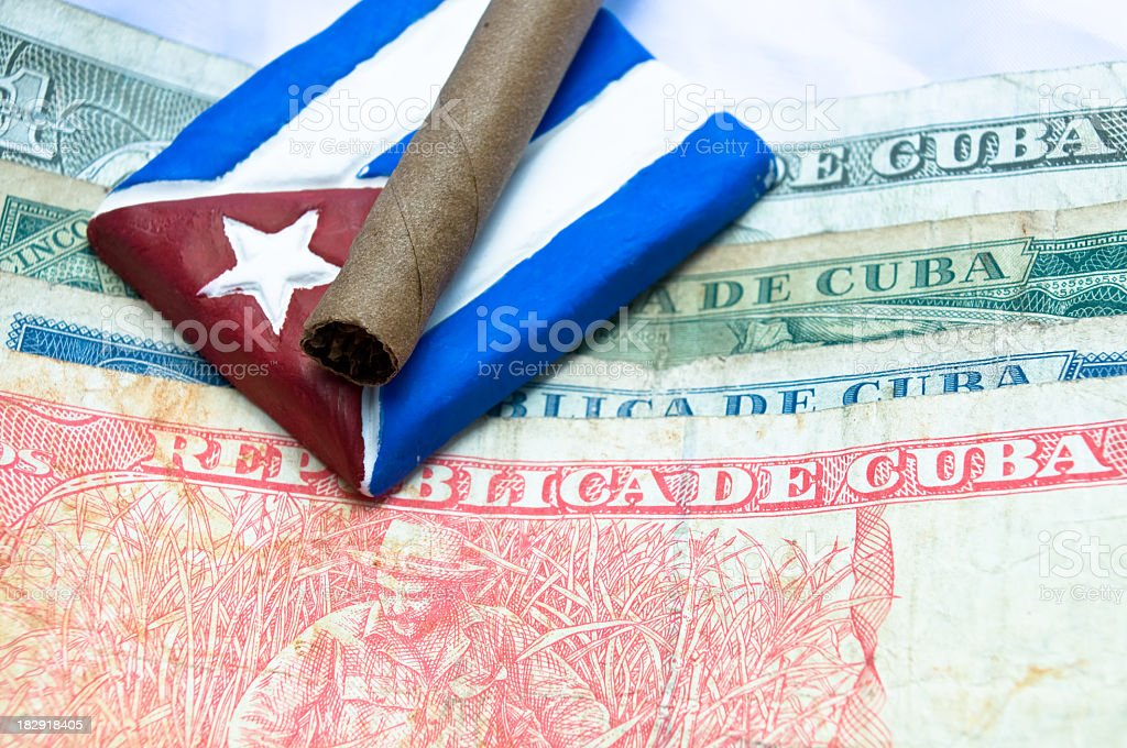 Cuban peso money and a flag stock photo