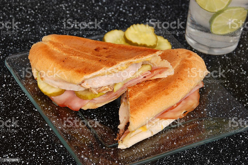 Cuban sandwich on plate with pickles stock photo