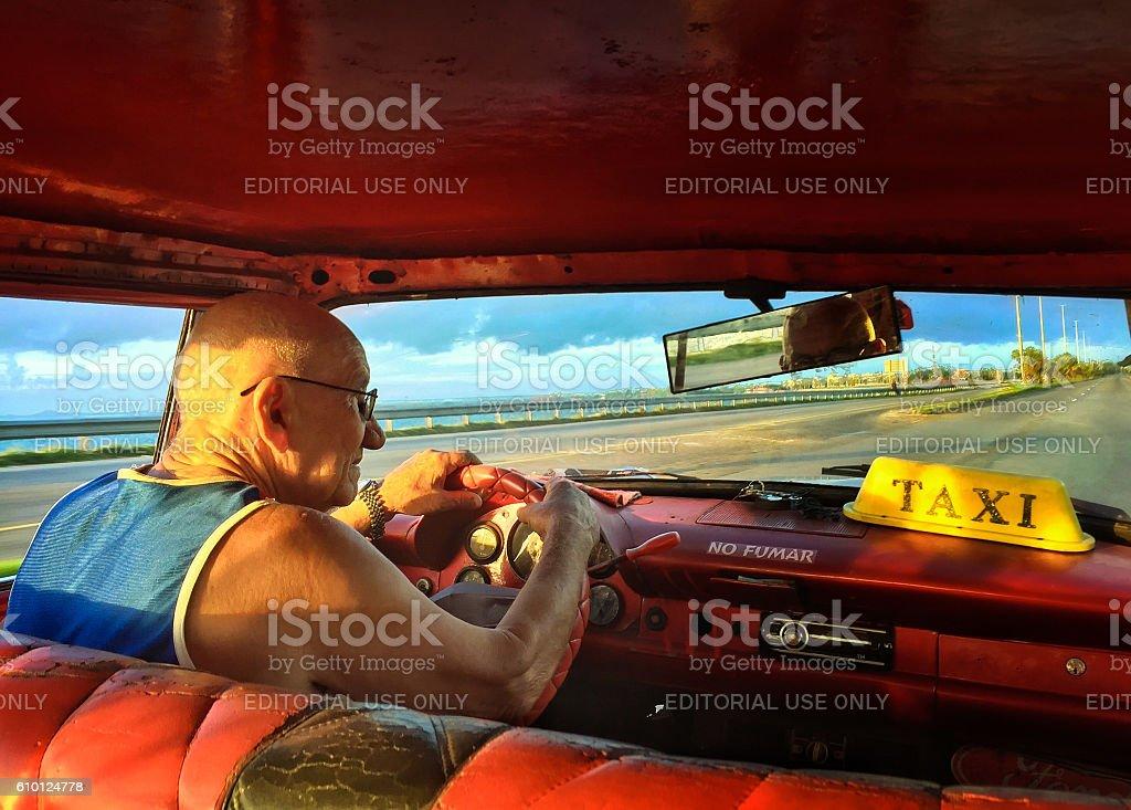 Cuban taxi driver stock photo
