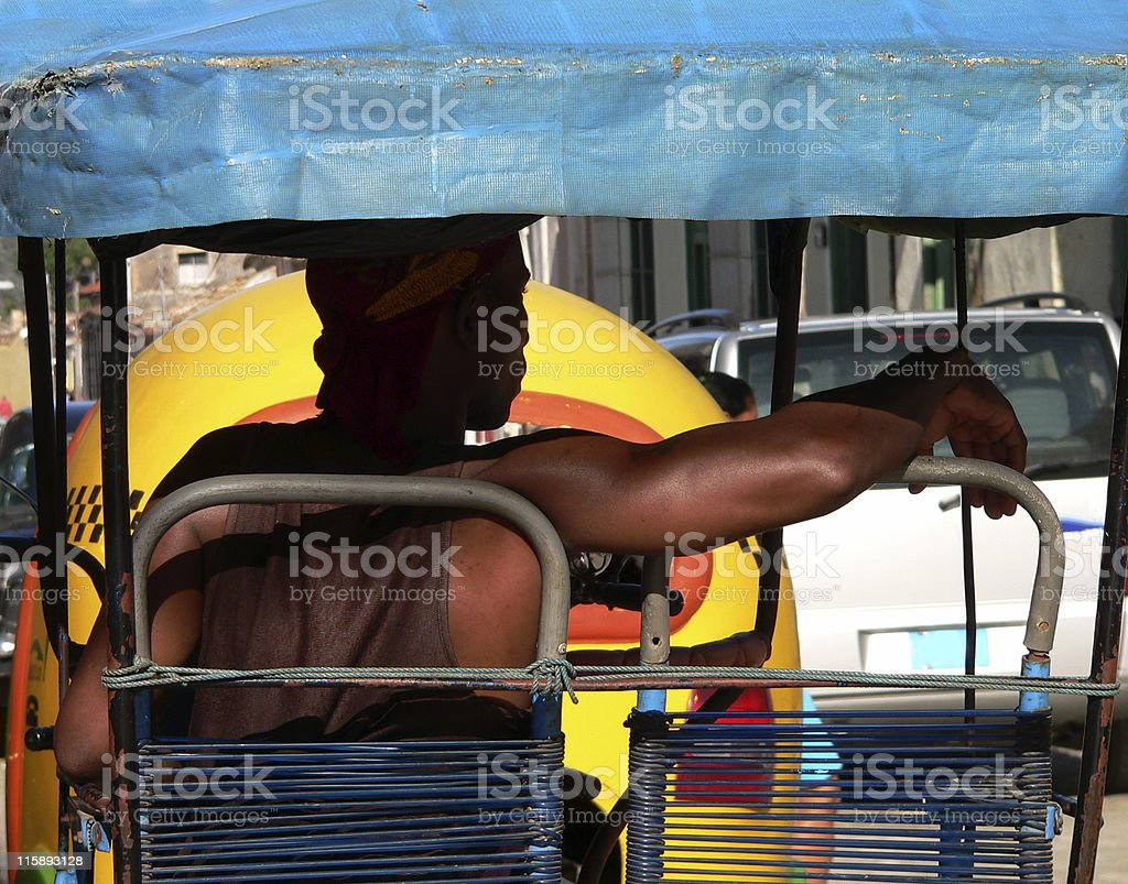 Cuban Taxi driver waiting for customers in bicycle-taxi Trinidad, Cuba royalty-free stock photo