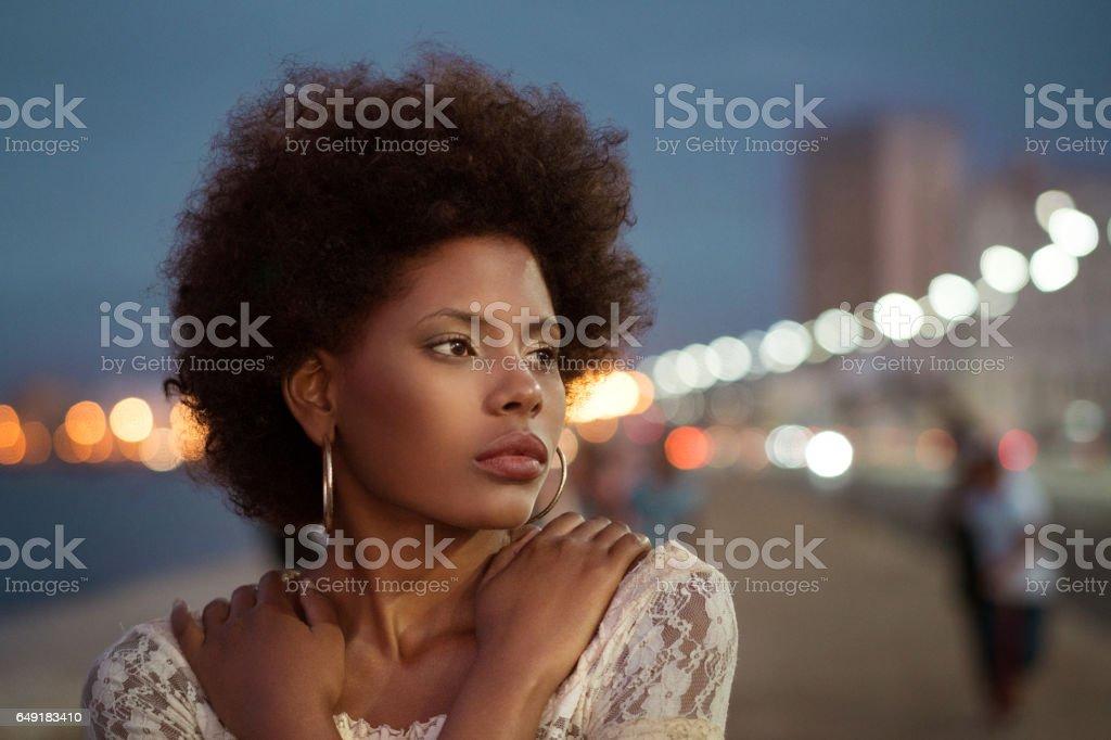 Cuban woman in Havana, Sunset On The Malecon stock photo