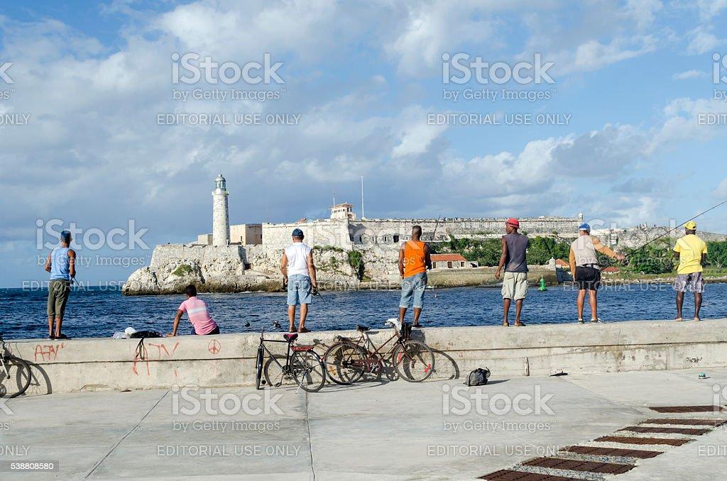 Cubans fishermens in Old Havana. stock photo