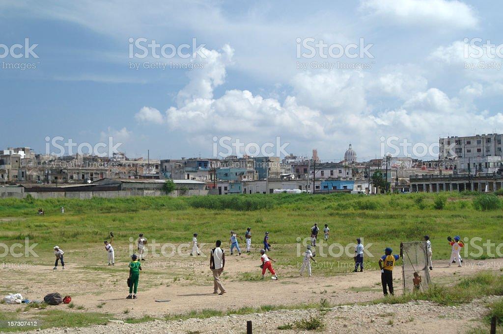 Cubans Playing Baseball Game on Cuban Sports Field stock photo