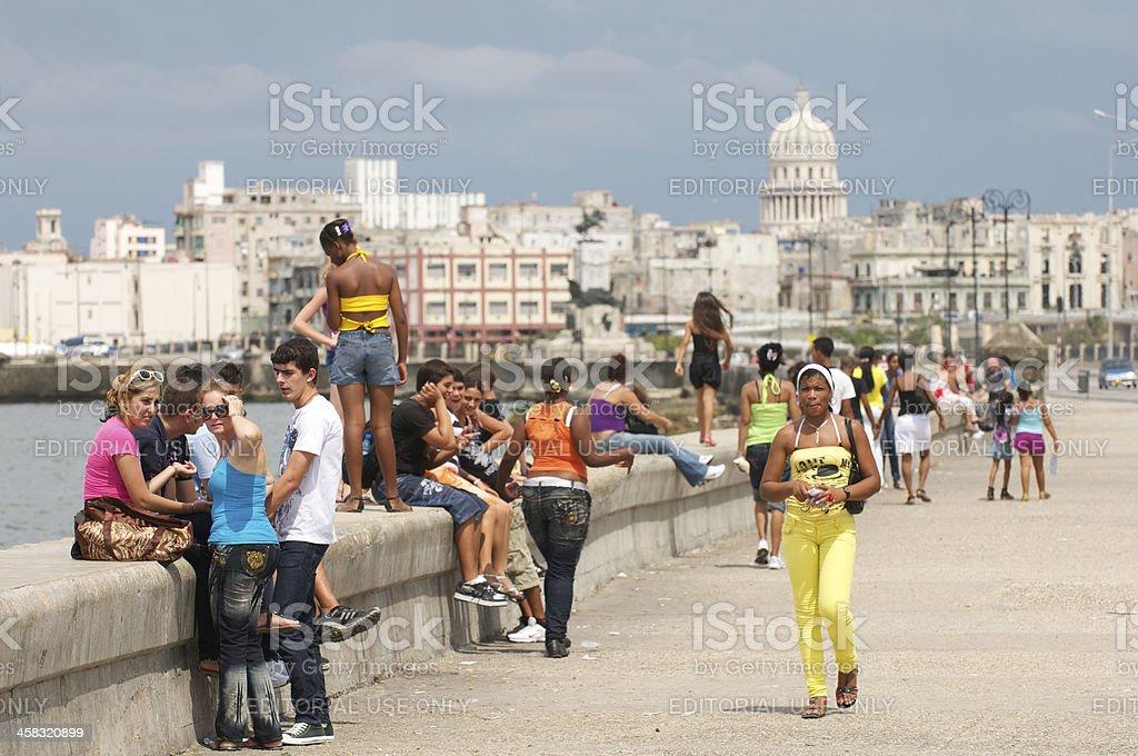 Cubans Relax on Malecon Havana Cuba stock photo
