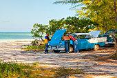 Cubans repair an old classic American vintage car