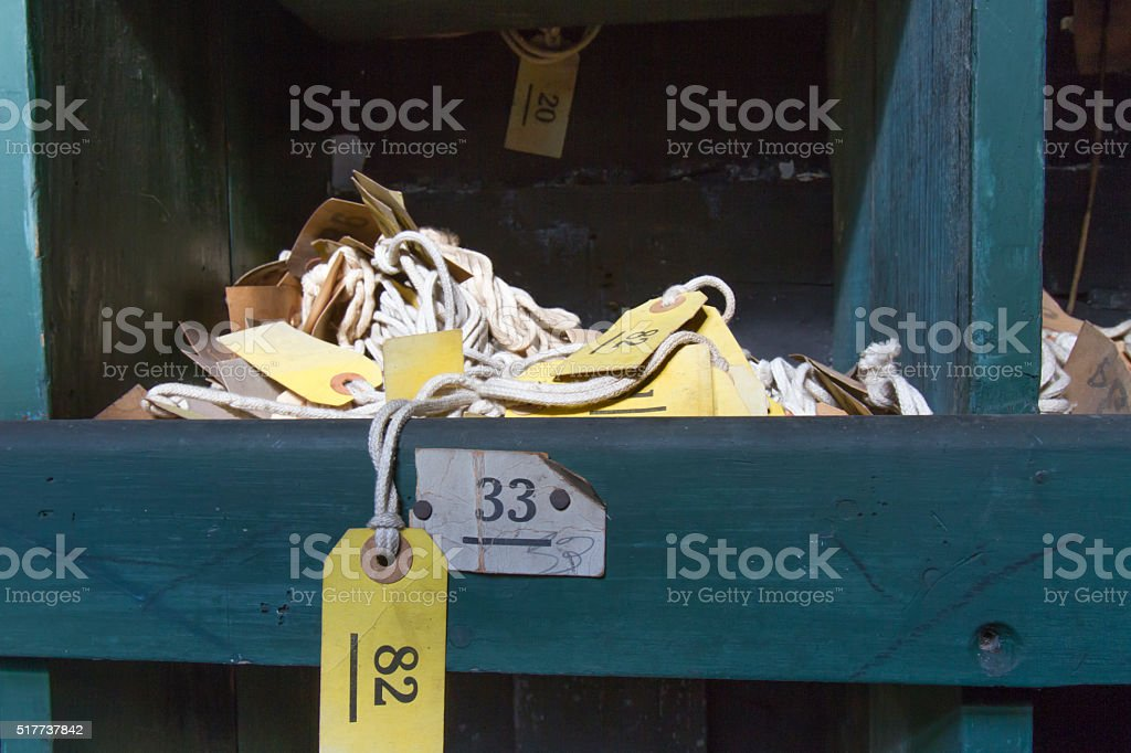 Cubby with labels on rope stock photo