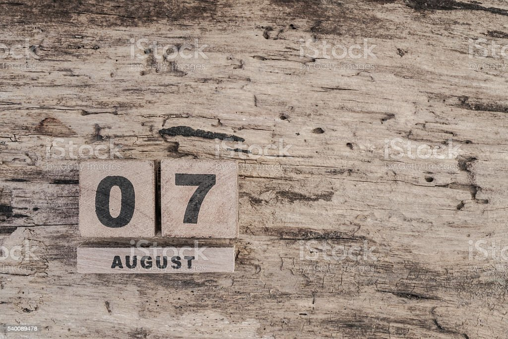 cube calendar for august on wooden background with copy space stock photo