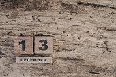 cube calendar for december on wooden background