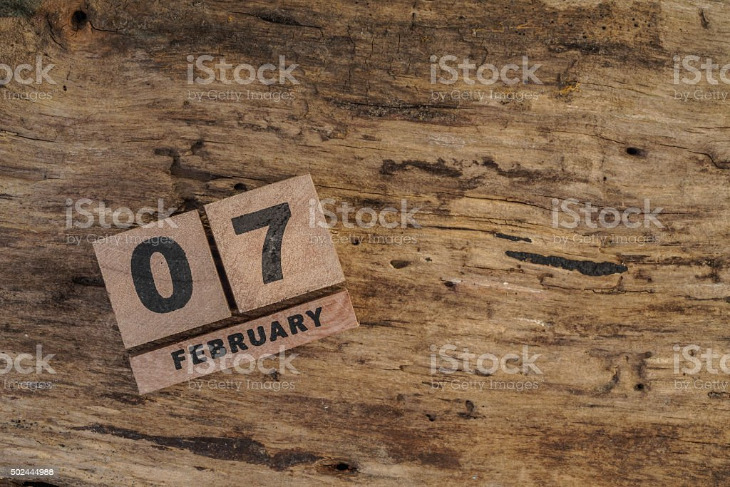 cube calendar for february on wood stock photo