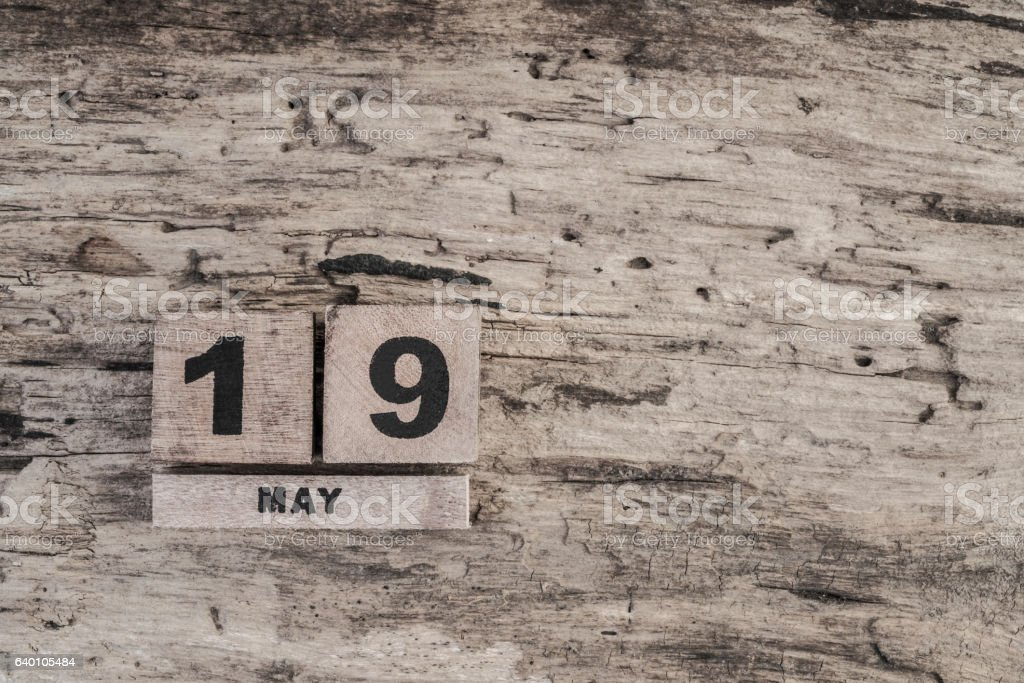 Cube calendar for may on wooden background stock photo