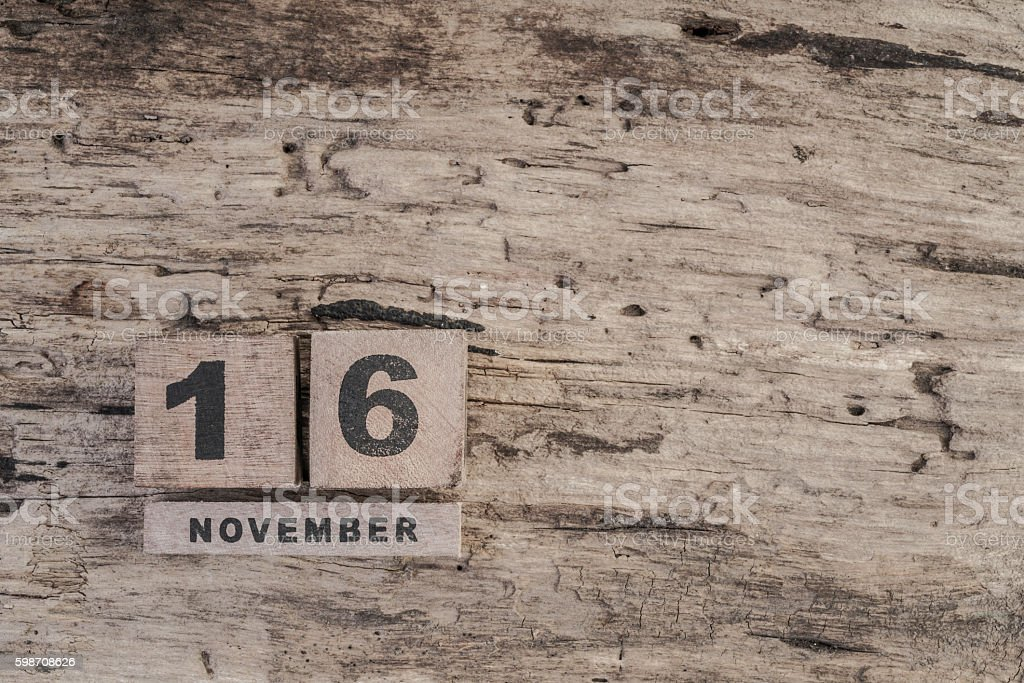 cube calendar for november on wooden background with copy space stock photo