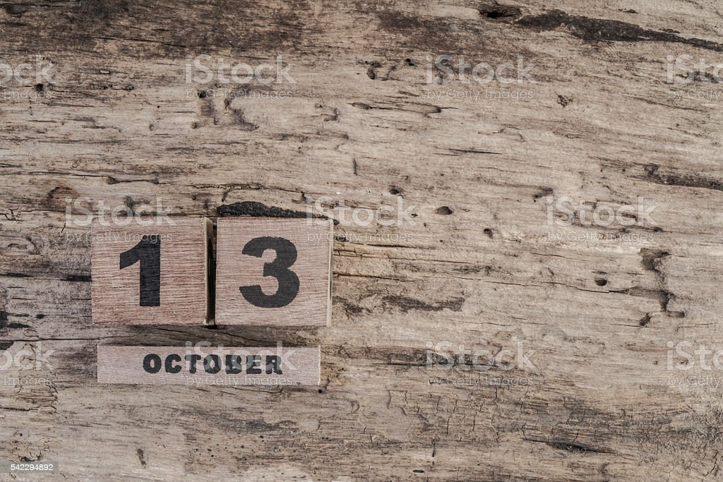 cube calendar for october on wooden background with copy space stock photo