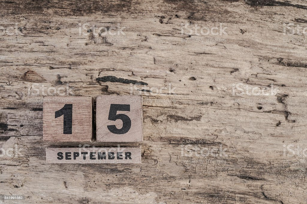 cube calendar for september on wooden background with copy space stock photo