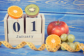 Cube calendar, fruits and tape measure, new years resolutions