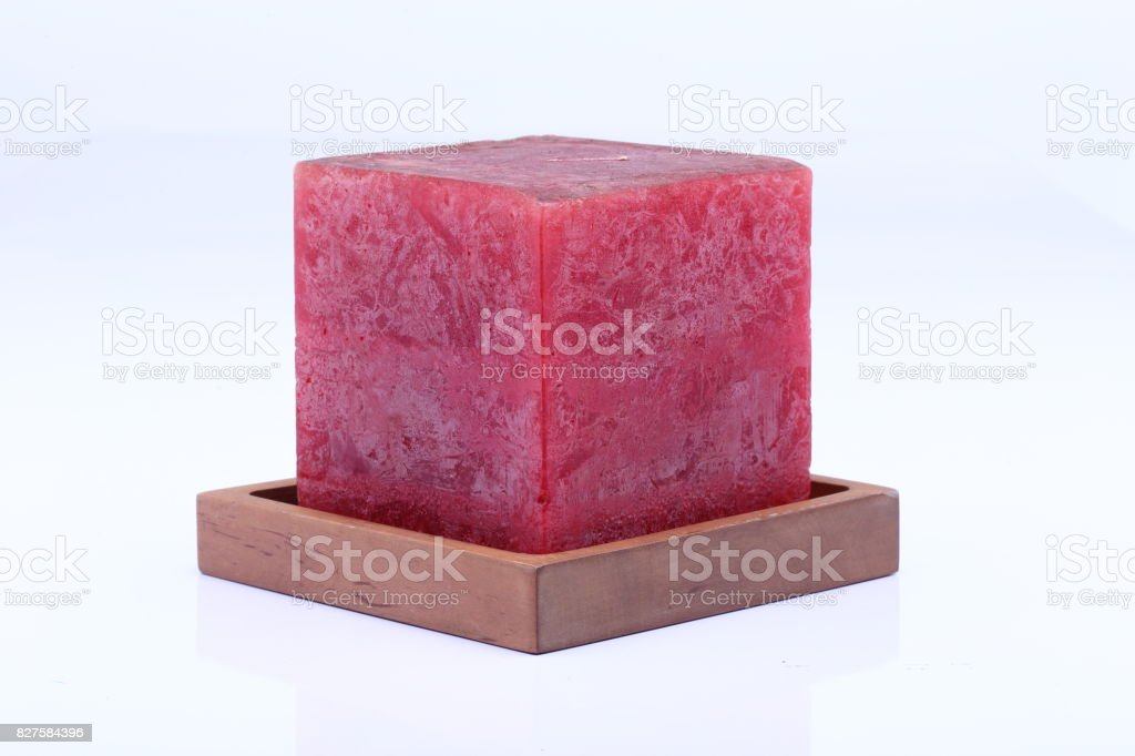 Cube Square Red Marble Candle on Teak Wood stand stock photo
