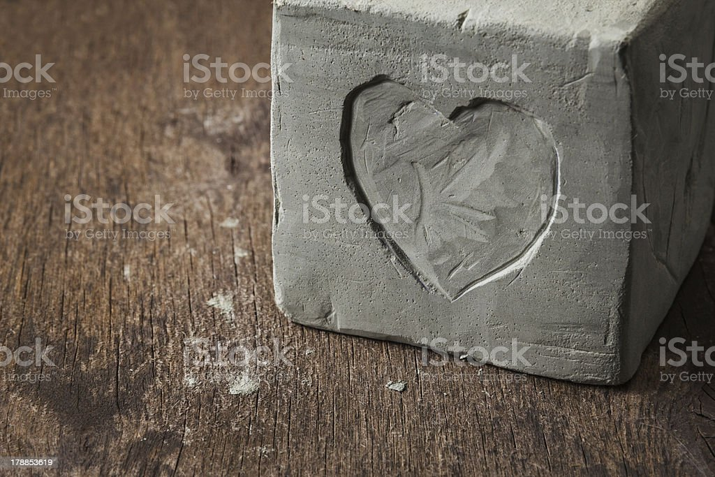 cube with clay heart on wooden surface royalty-free stock photo