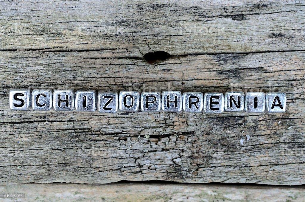 cube word schizophrenia on table stock photo