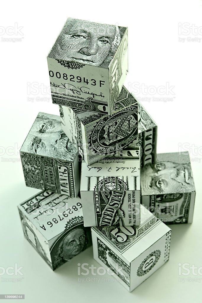 Cubes of cash stacked up like a tower as a financial concept royalty-free stock photo