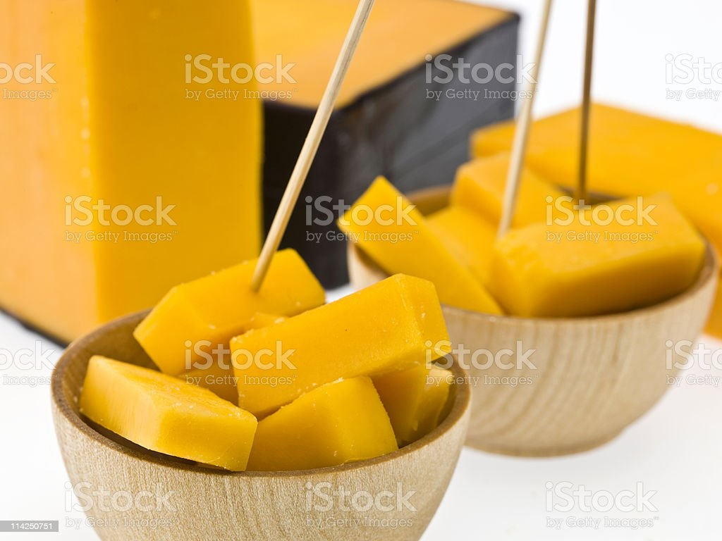 Cubes of yellow cheddar in bowls with toothpicks. royalty-free stock photo