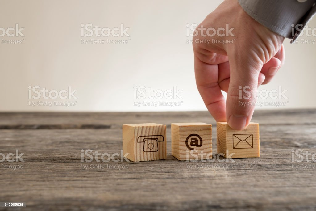 Cubes with contact symbols stock photo