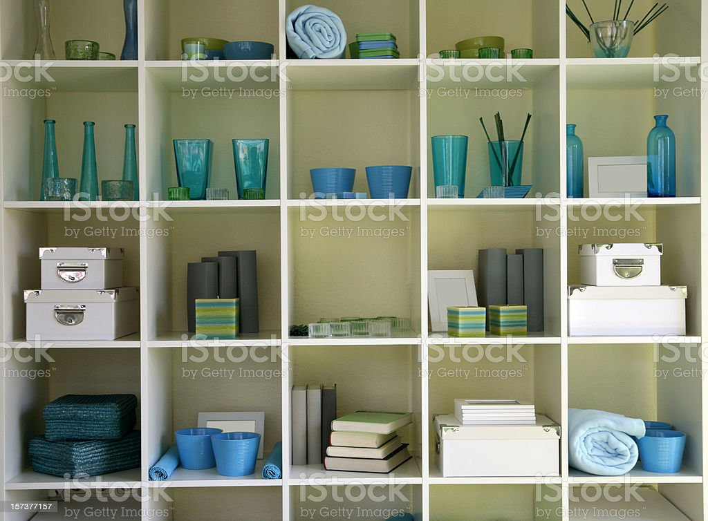 Cubicles holding various home items royalty-free stock photo