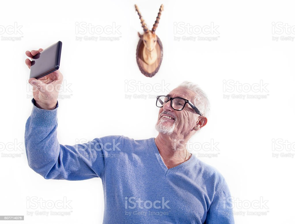 cuckold man takes a selfie after betrayal stock photo