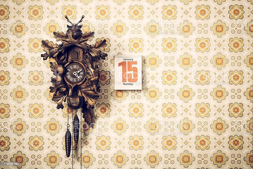 Cuckoo Clock and Calendar on Retro Wallpaper stock photo