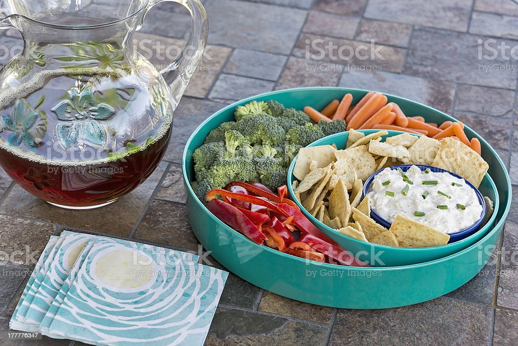 Cucumber dip with a chips & vegetable tray royalty-free stock photo