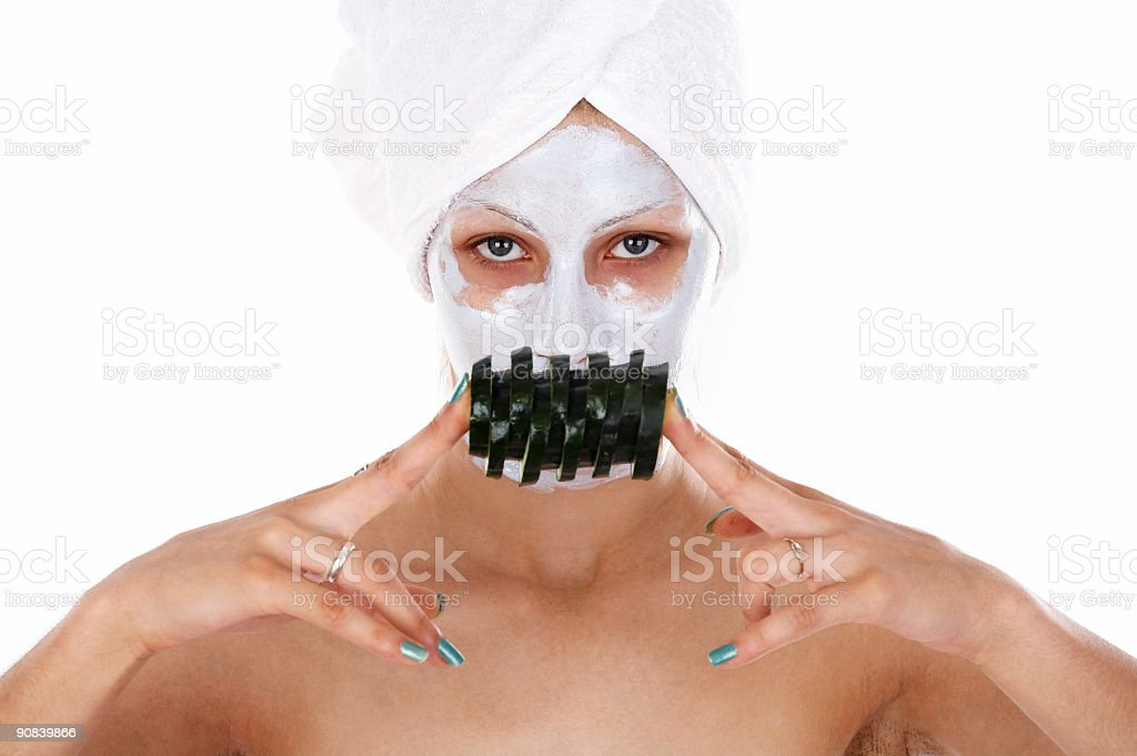 Cucumber facial mask stock photo