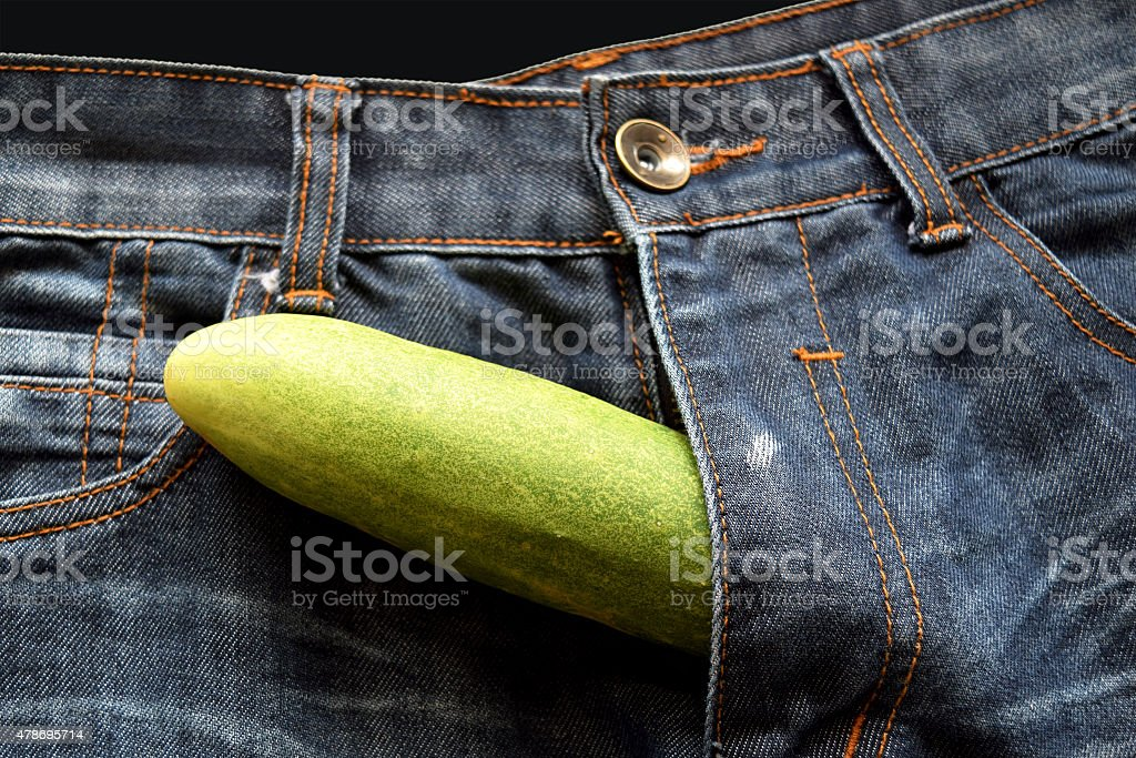 cucumber is the mark of penis in jean stock photo