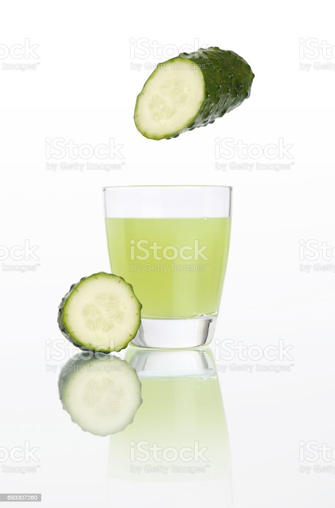 cucumber juice in glass isolated on white background stock photo