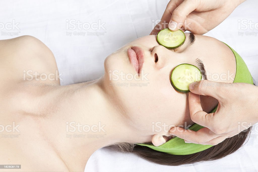 Cucumber over eyes royalty-free stock photo