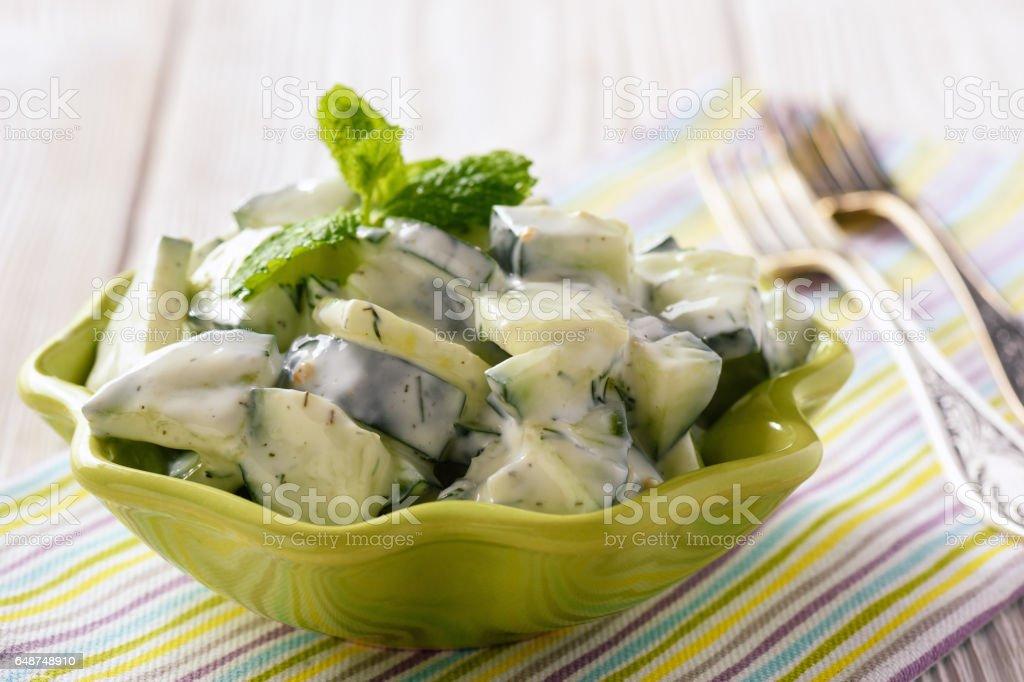 Cucumber salad with natural yogurt, garlic and dill. stock photo