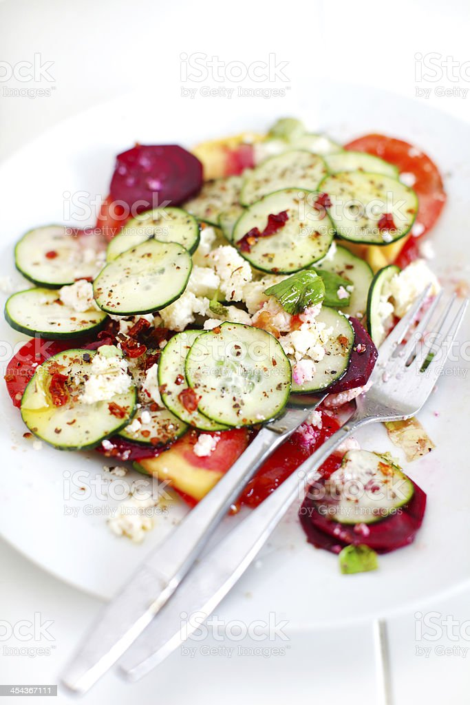 Cucumber salad with tomatoes, cottage cheese and chili royalty-free stock photo