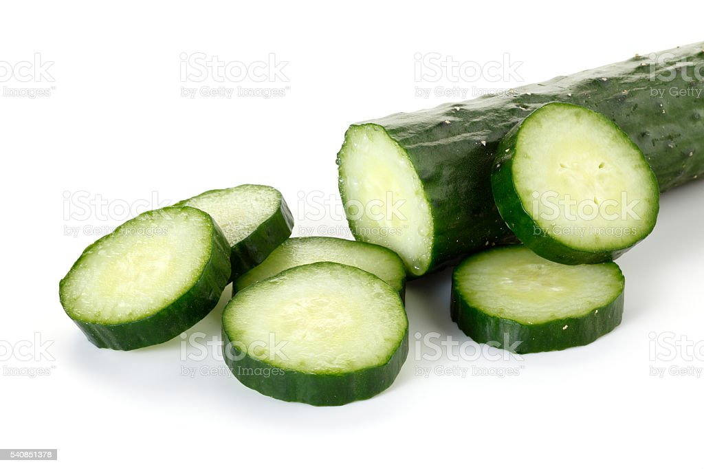 Cucumber slices on a white background stock photo