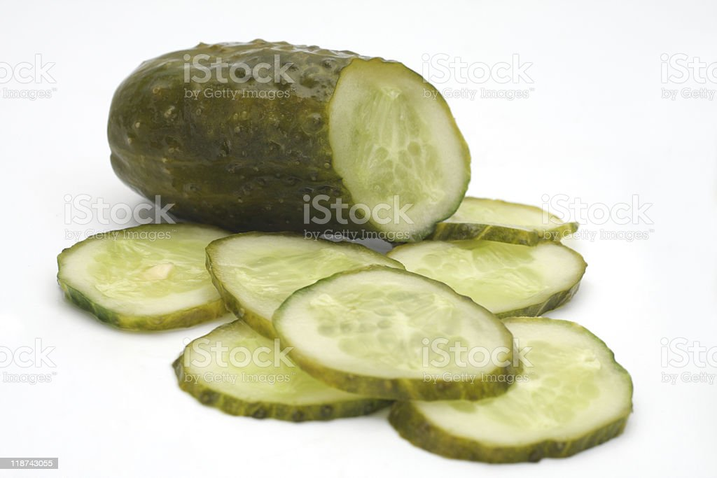 Cucumber slices on white background stock photo