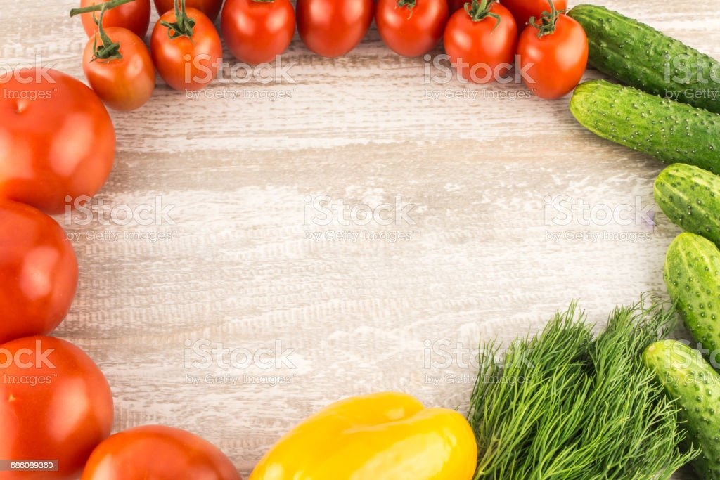 Cucumber, tomato, pepper and fennel on a white wooden background close up copy space. stock photo