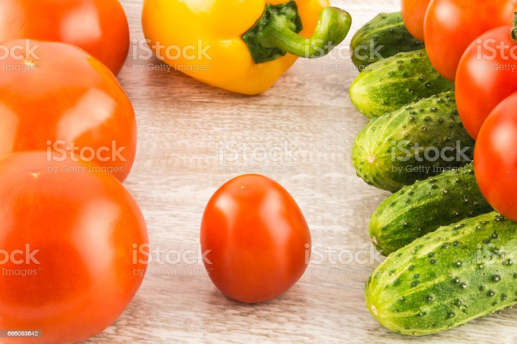 Cucumber, tomato, pepper and fennel on a white wooden background close up. stock photo
