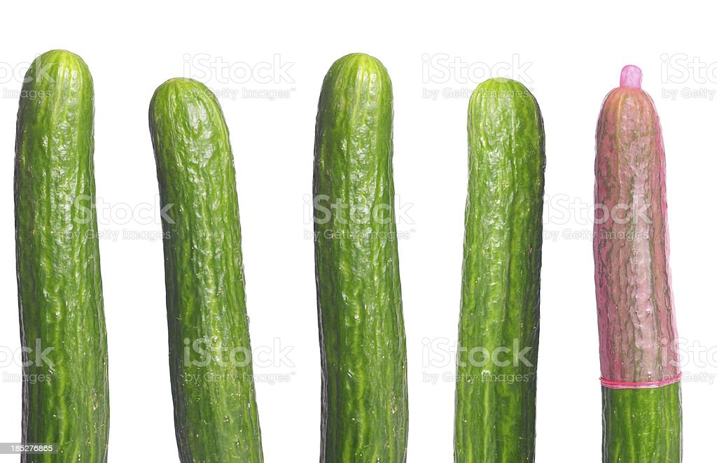 Cucumber with pink condom royalty-free stock photo