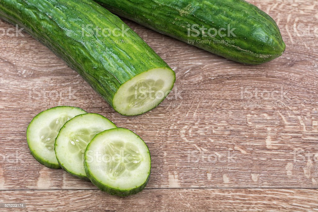 Cucumbers on a wooden background stock photo