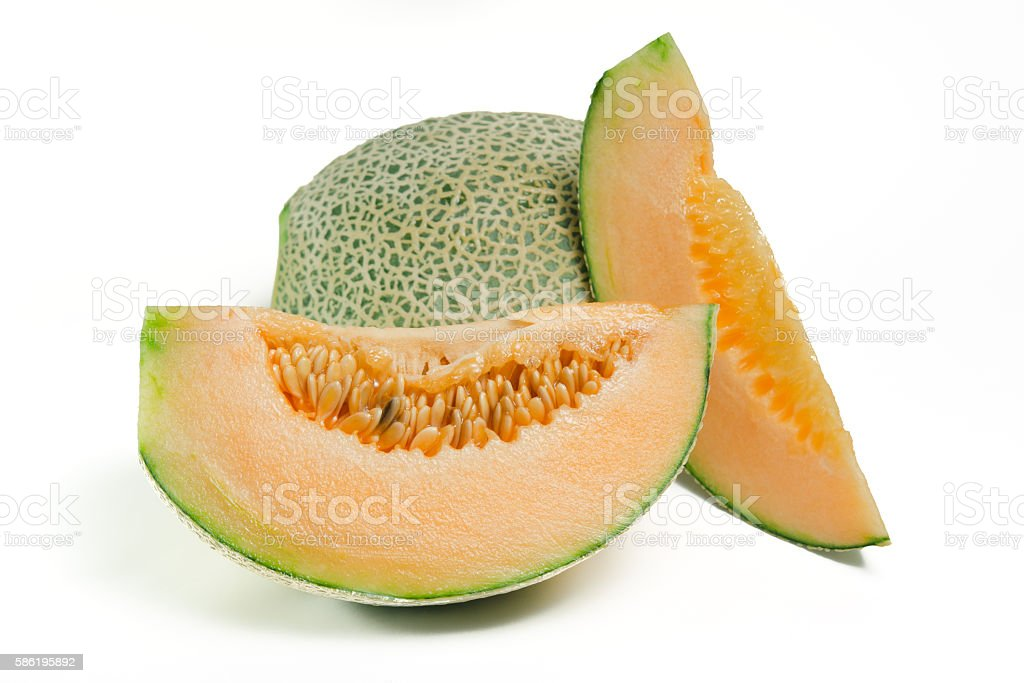 Cucumis melo or melon with half and seeds on white stock photo