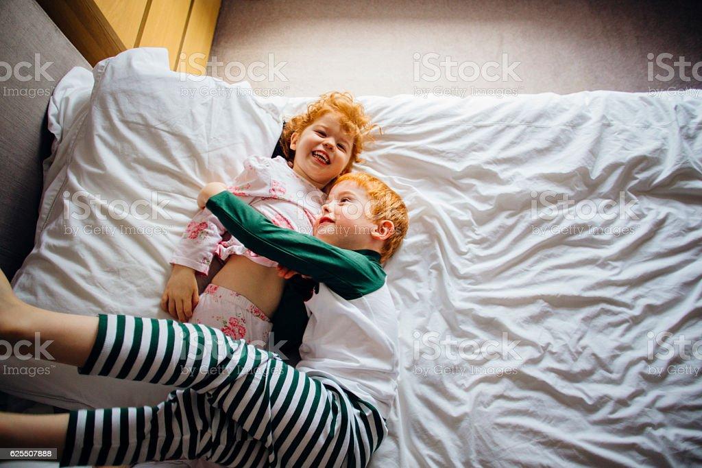 Cuddles in Mum's Bed stock photo