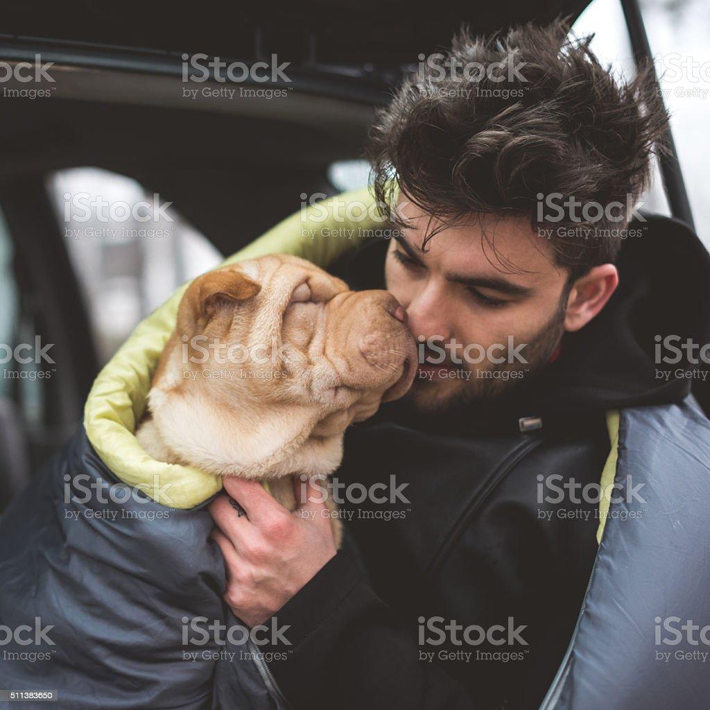 Cuddling a dog stock photo