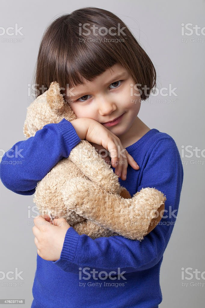cuddling and hugging for preschool child for serenity and peacefulness stock photo