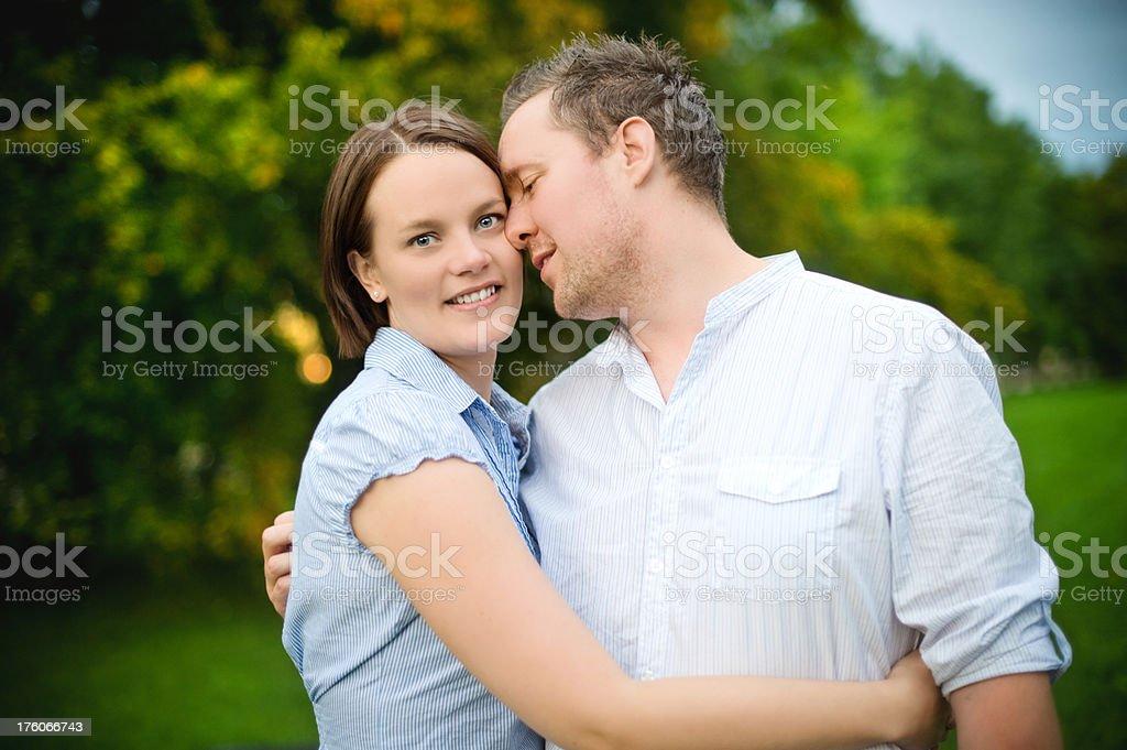 Cuddling beautiful couple outdoors royalty-free stock photo
